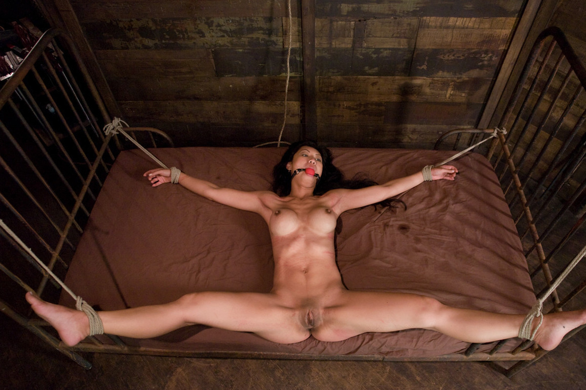Roped and ball-gagged all girl..