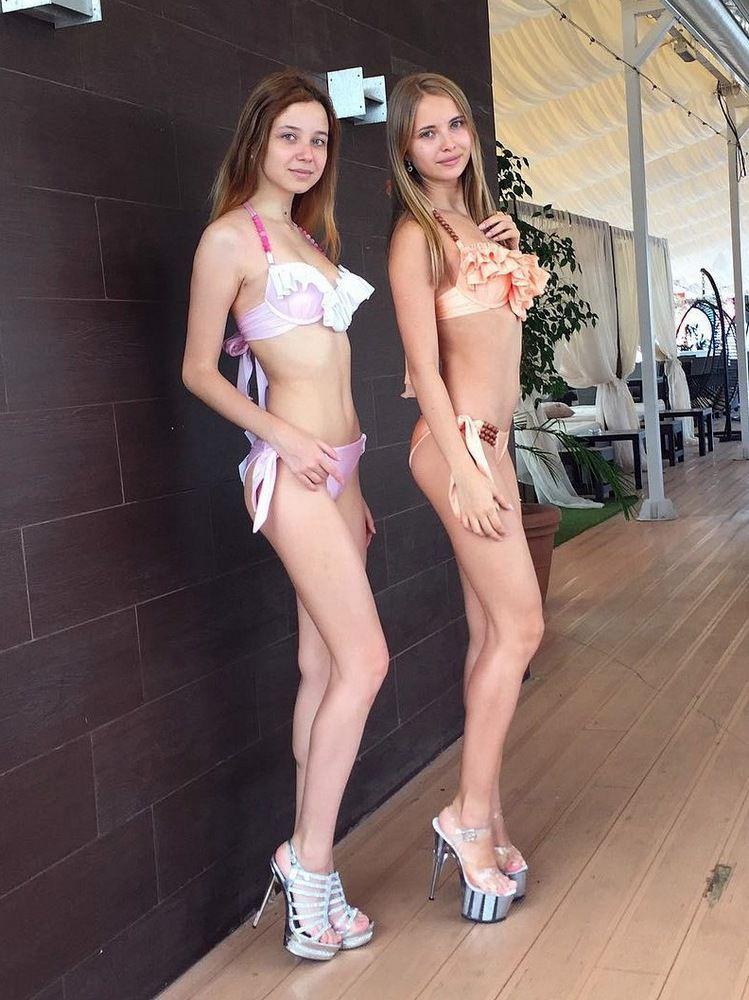 A long-legged teen little girl in a..